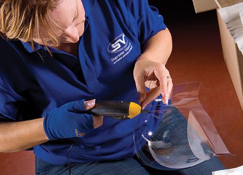 Supreme Visors staff member constructing visors