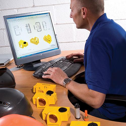 Supreme Visors staff member working on CAD drawings
