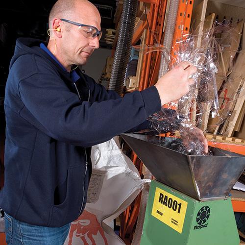 Supreme Visors staff member recycling visor material